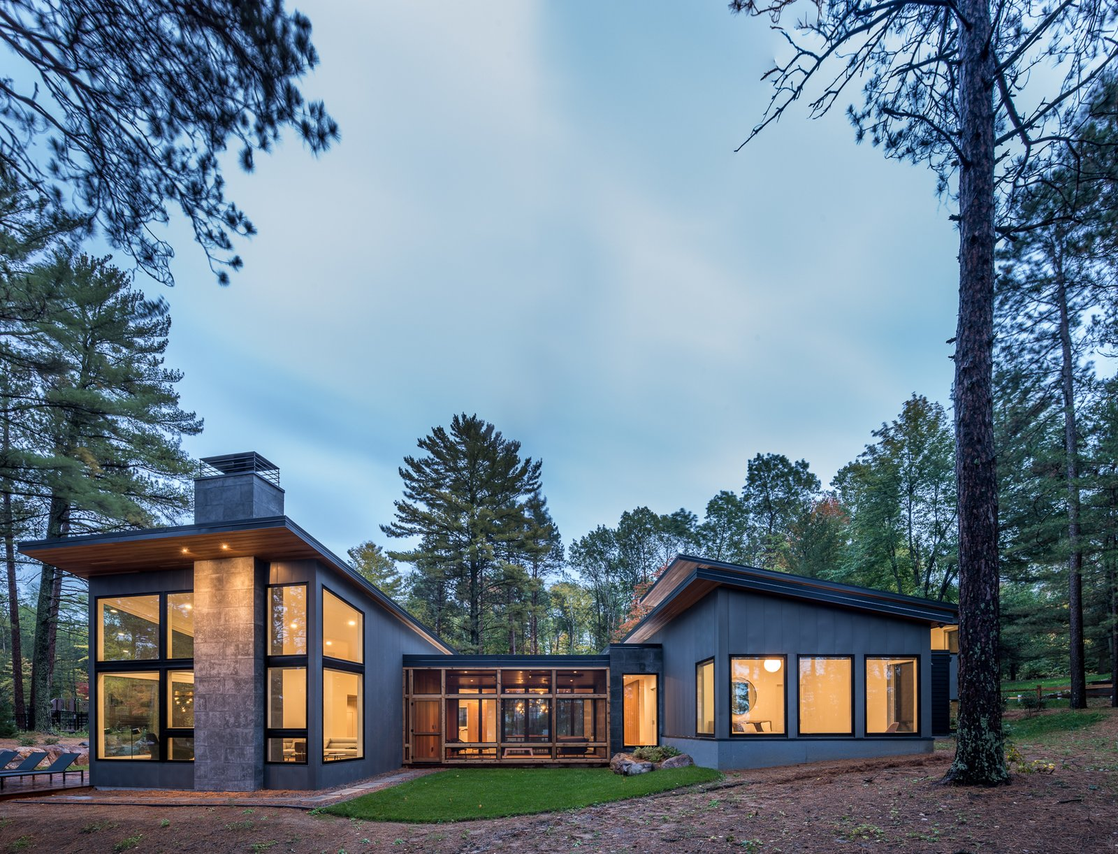 Exterior, Metal Roof Material, House Building Type, Cabin Building Type, Wood Siding Material, Concrete Siding Material, Metal Siding Material, Stone Siding Material, Flat RoofLine, and Shed RoofLine  Northern Lake Home by Strand Design