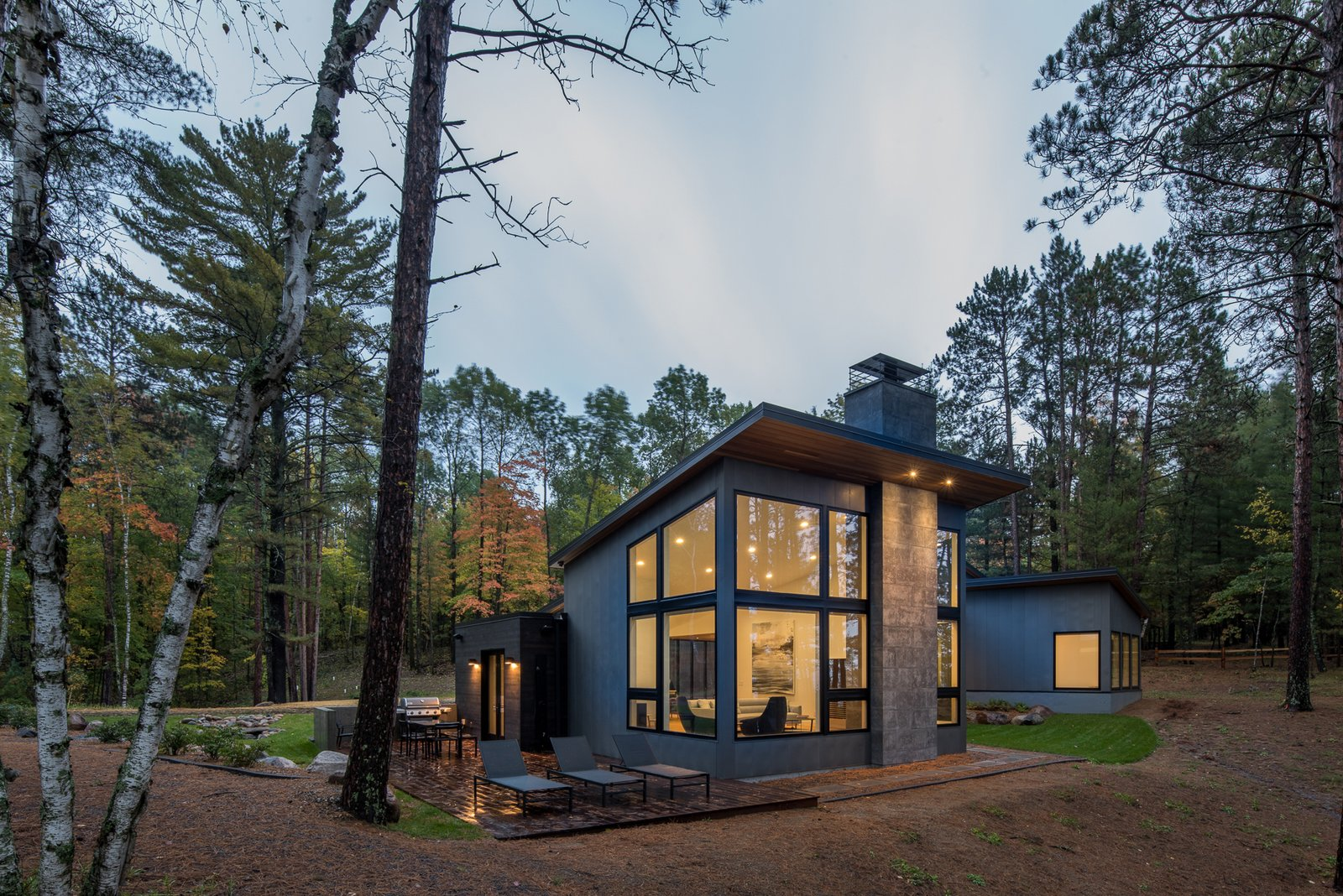 Exterior, House Building Type, Cabin Building Type, Metal Roof Material, Concrete Siding Material, Metal Siding Material, Wood Siding Material, Stone Siding Material, Shed RoofLine, and Flat RoofLine  Northern Lake Home by Strand Design