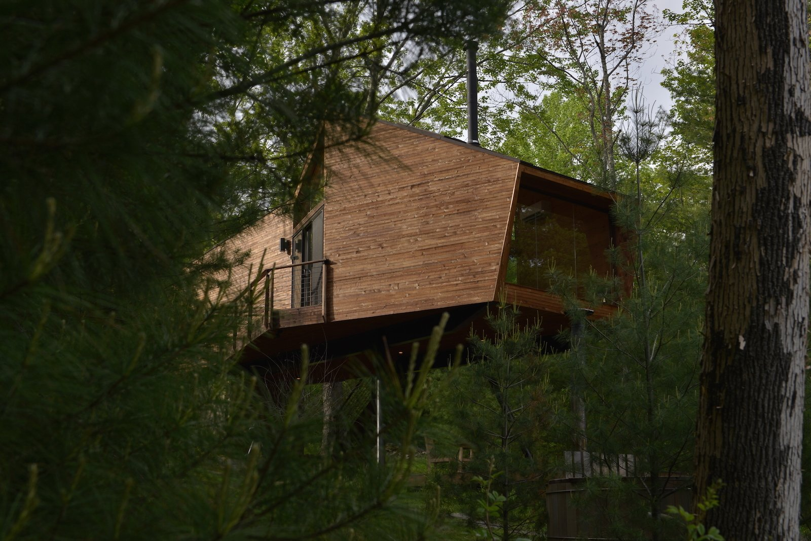 Exterior, Cabin Building Type, Wood Siding Material, and Shed RoofLine  Photo 2 of 11 in Sleep in This Romantic Tree House Just Outside NYC