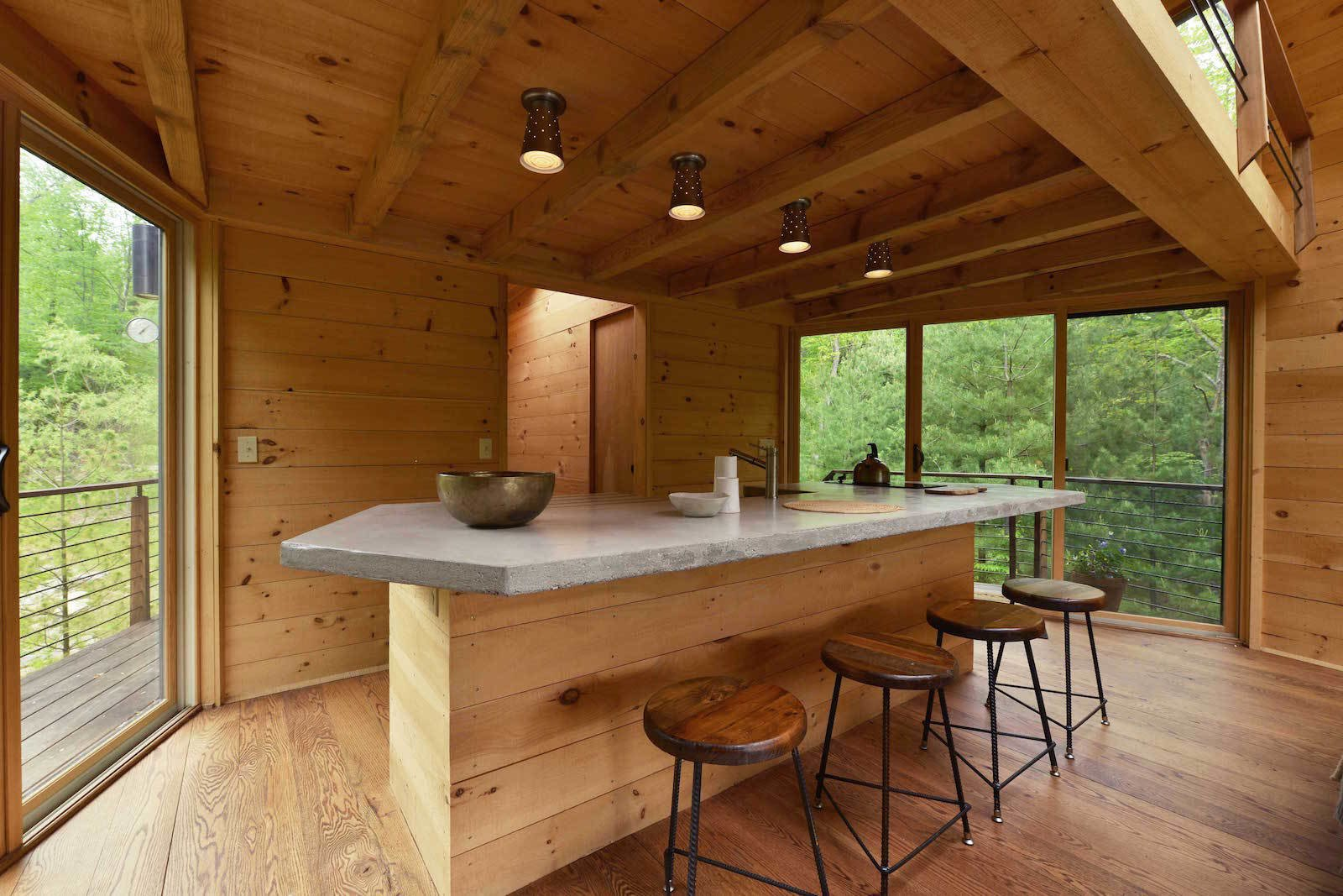 Kitchen, Concrete Counter, Medium Hardwood Floor, Ceiling Lighting, and Undermount Sink  Photo 8 of 11 in Sleep in This Romantic Tree House Just Outside NYC