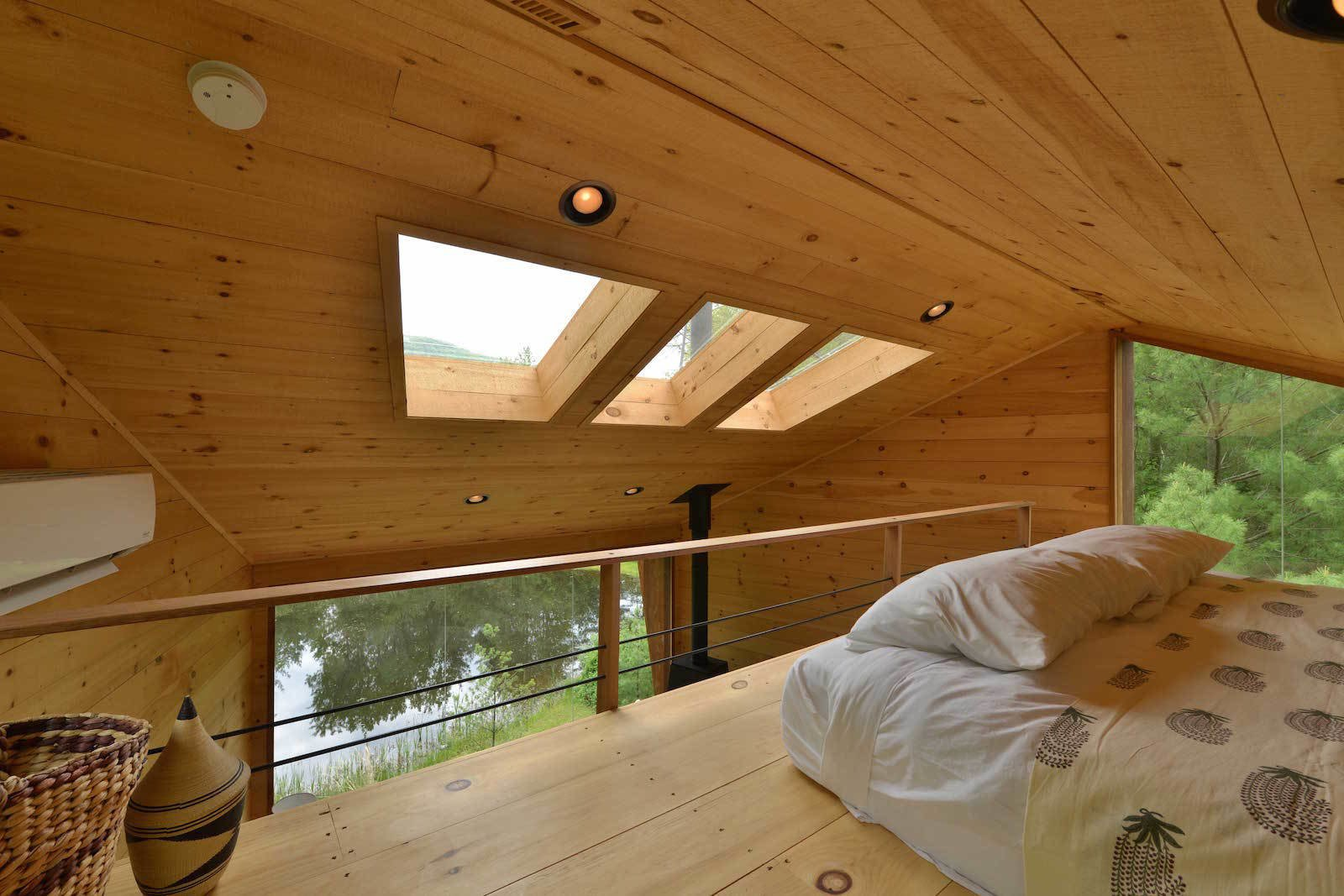 Bedroom, Bed, Recessed Lighting, and Medium Hardwood Floor  Photo 10 of 11 in Sleep in This Romantic Tree House Just Outside NYC