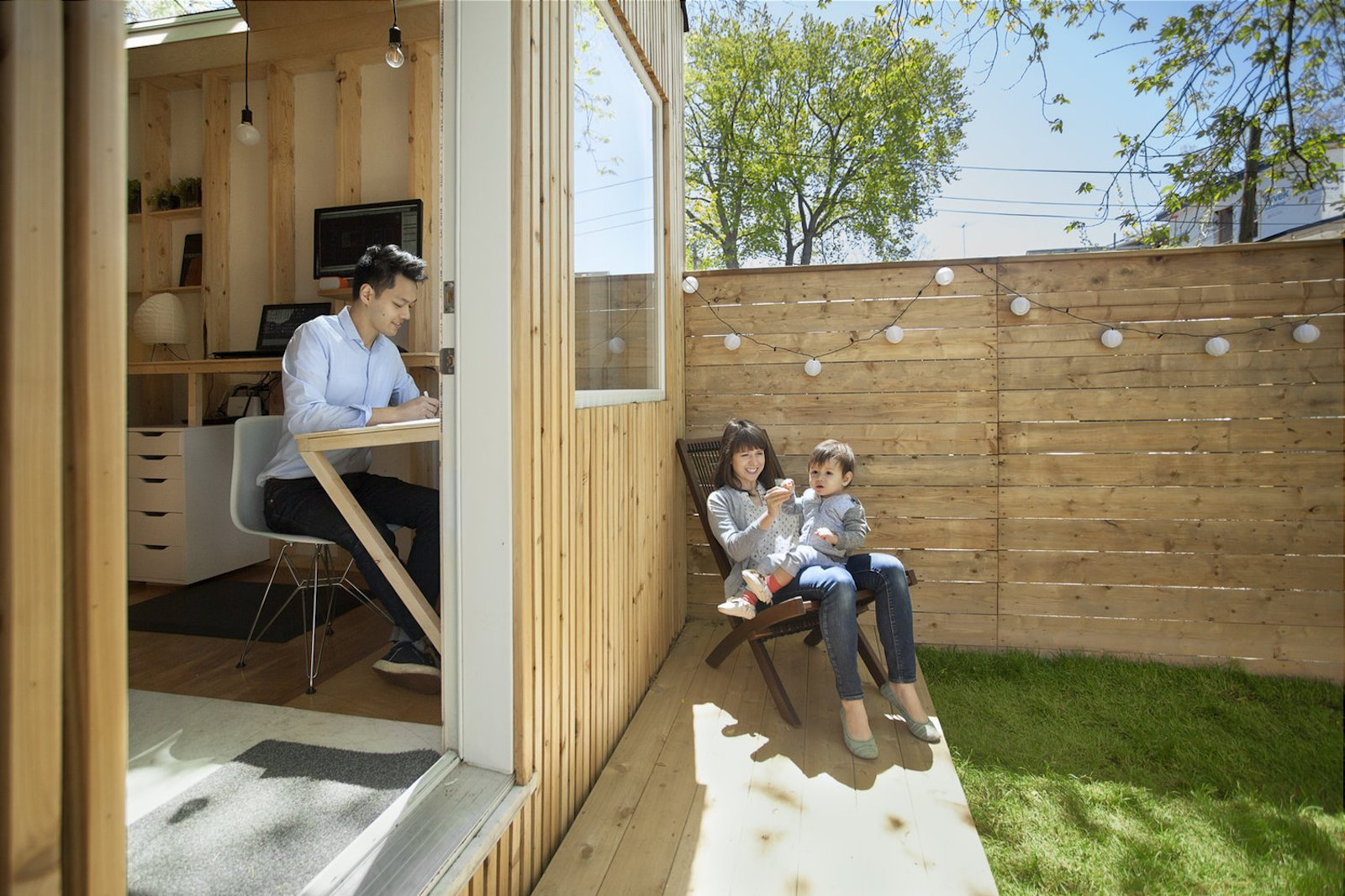 Outdoor, Trees, Grass, Small Patio, Porch, Deck, Wood Patio, Porch, Deck, Horizontal Fences, Wall, Wood Fences, Wall, Hanging Lighting, and Back Yard  Photo 8 of 10 in This Architect's Tiny Studio Is the Ultimate Backyard Workspace