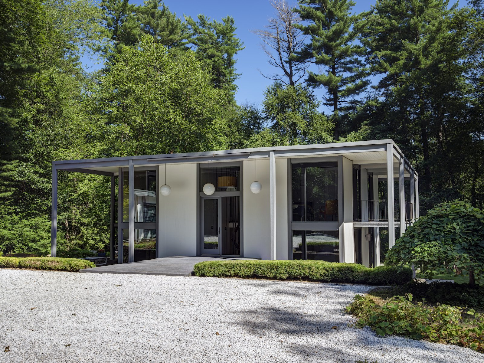 Exterior, House Building Type, Metal Roof Material, Metal Siding Material, Glass Siding Material, and Flat RoofLine  Photo 2 of 13 in A Showstopping Midcentury in New Canaan Hits the Market