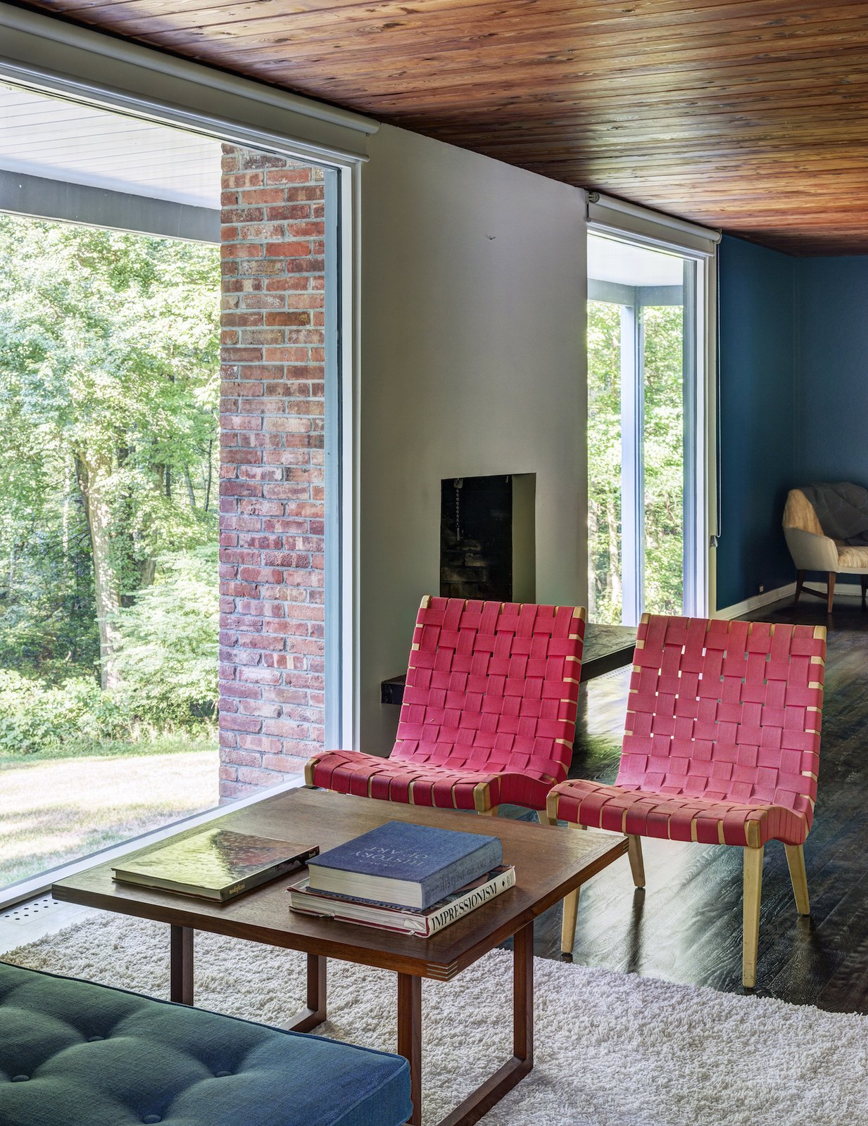 Living Room, Chair, Coffee Tables, Dark Hardwood Floor, Rug Floor, and Standard Layout Fireplace  Photo 4 of 13 in A Showstopping Midcentury in New Canaan Hits the Market