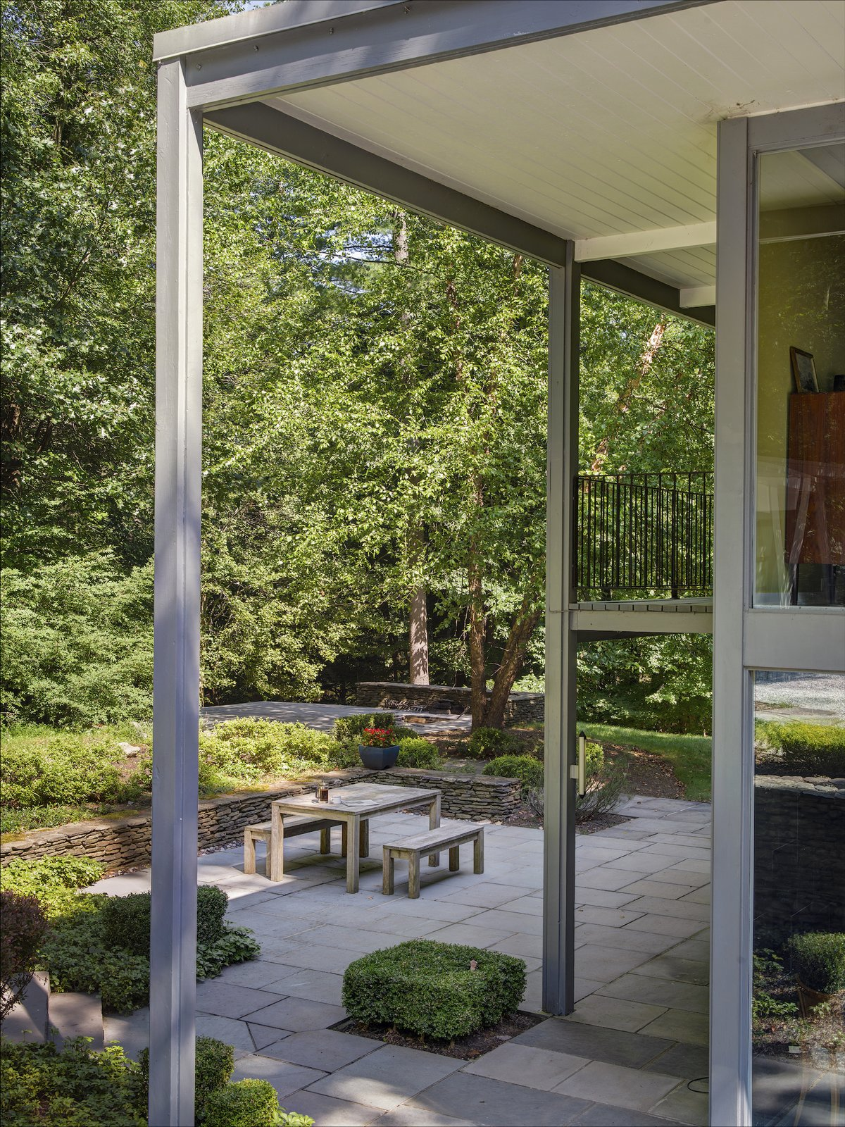 Outdoor, Large Patio, Porch, Deck, Pavers Patio, Porch, Deck, Shrubs, and Trees  Photo 7 of 13 in A Showstopping Midcentury in New Canaan Hits the Market