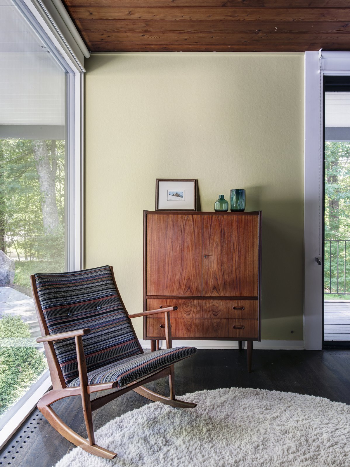 Bedroom, Rug, Rockers, Dark Hardwood, and Storage  Bedroom Rockers Photos from A Showstopping Midcentury in New Canaan Hits the Market