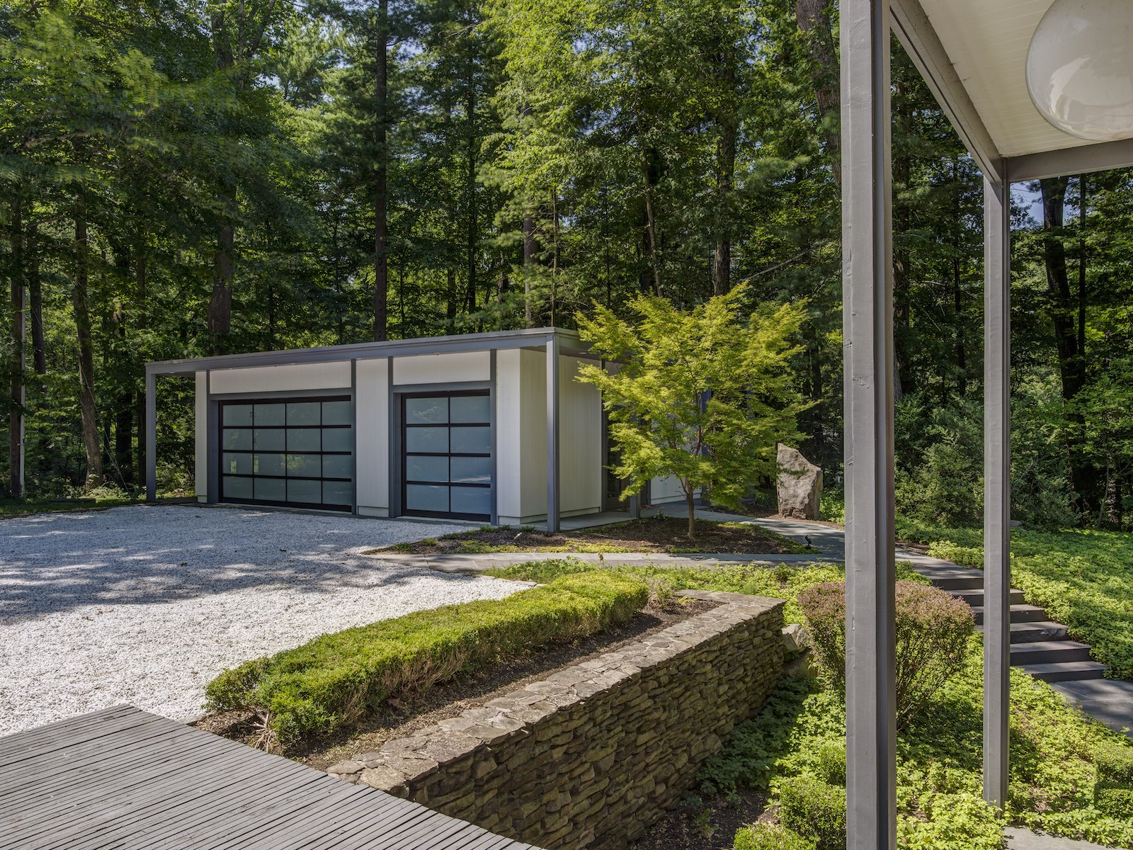 Garage and Detached Garage Room Type  Photo 12 of 13 in A Showstopping Midcentury in New Canaan Hits the Market