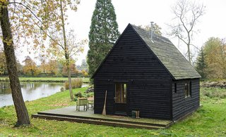 A labor of love, the 377-square-foot Woodland Cabin is a design/build project completed over multiple trips to the lakeside lot in the village of Nouvelles in southern Belgium. The architects built the cabin using locally-sourced, storm-felled timber to deepen their understanding of materials and construction.