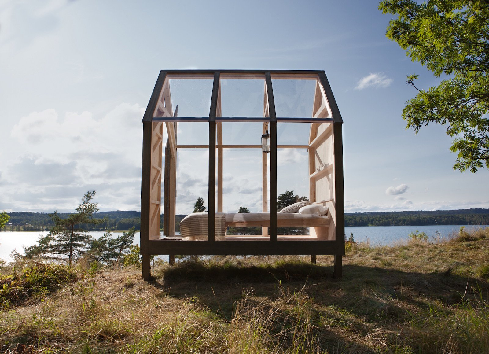 Exterior, Glass Siding Material, Gable RoofLine, and Cabin Building Type  Best Photos from Stressed Out? Sweden's 72 Hour Cabins Are Designed to Soothe