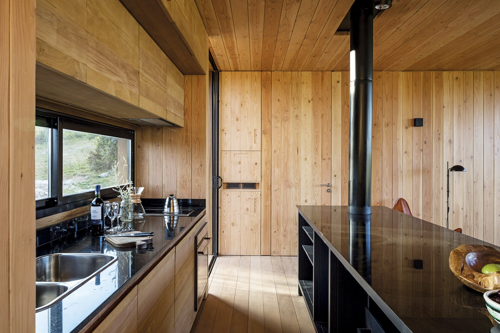 Kitchen and Wood Cabinet  Photo 6 of 16 in A Remote Prefab in Uruguay Is Completely Self-Sufficient