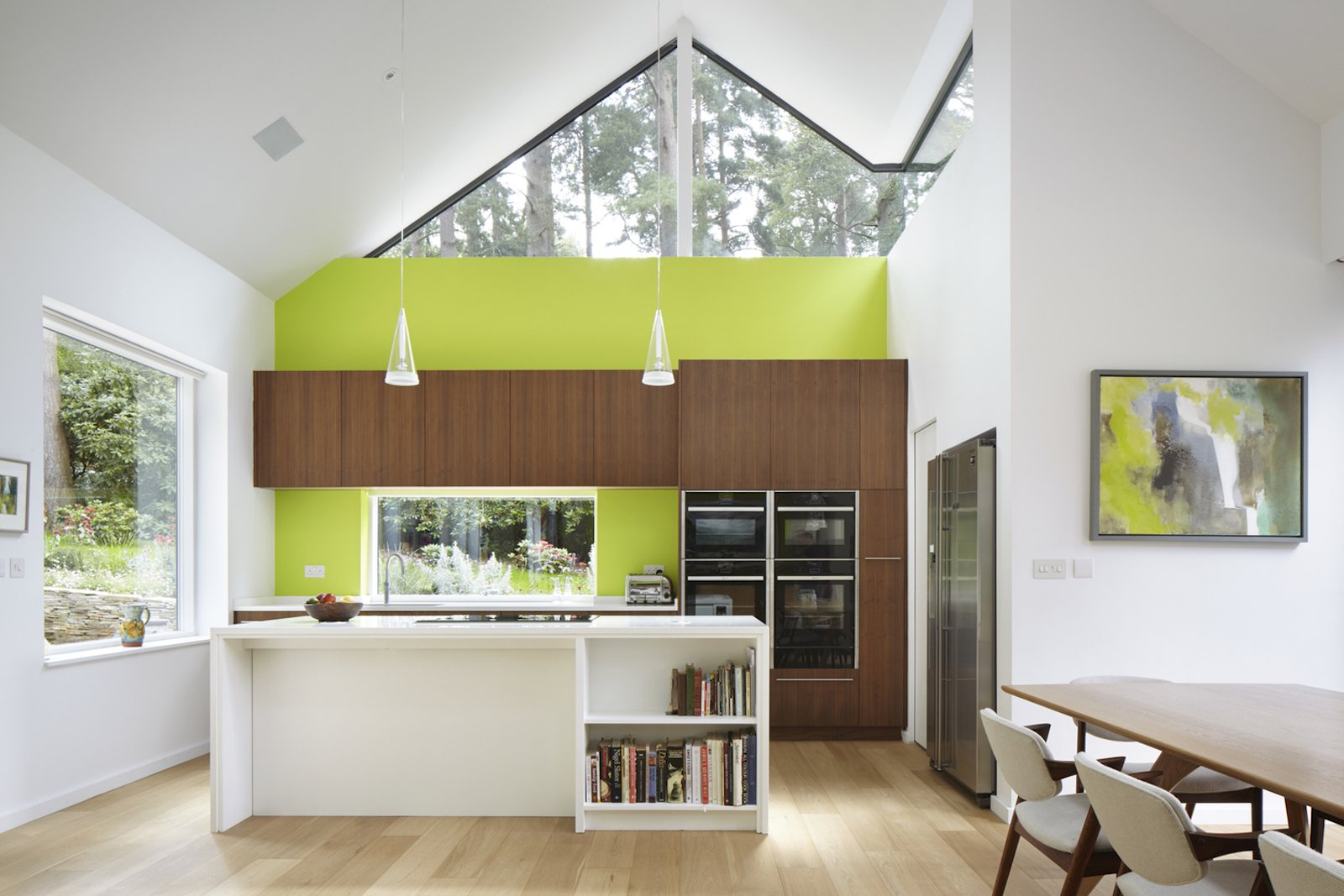 Kitchen, Wall Oven, Cooktops, Light Hardwood Floor, and Pendant Lighting  Photo 5 of 10 in Raised in Just 10 Days, This Airtight Prefab Is a Lesson in Efficiency