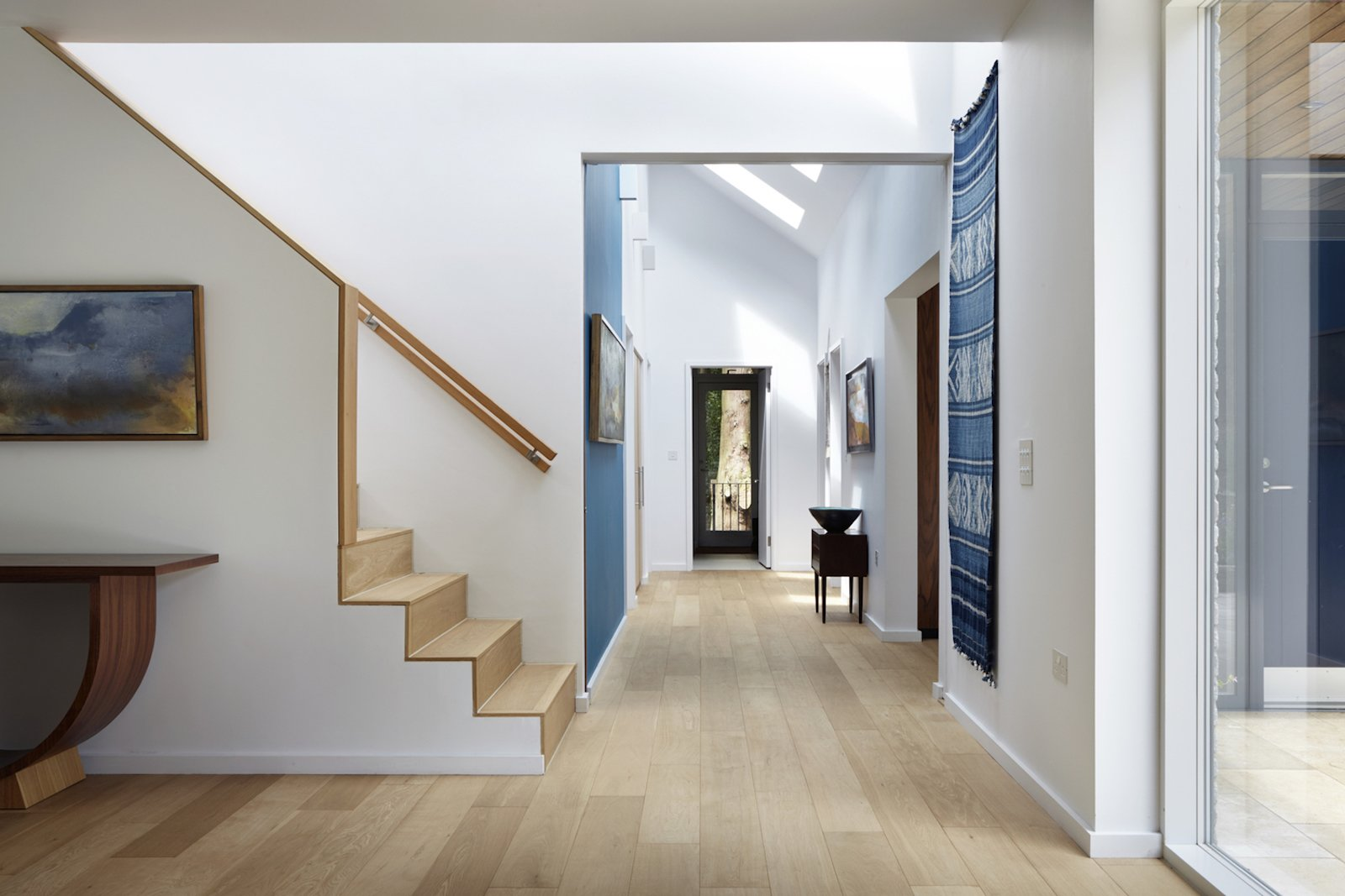 Hallway and Light Hardwood Floor  Photo 8 of 10 in Raised in Just 10 Days, This Airtight Prefab Is a Lesson in Efficiency