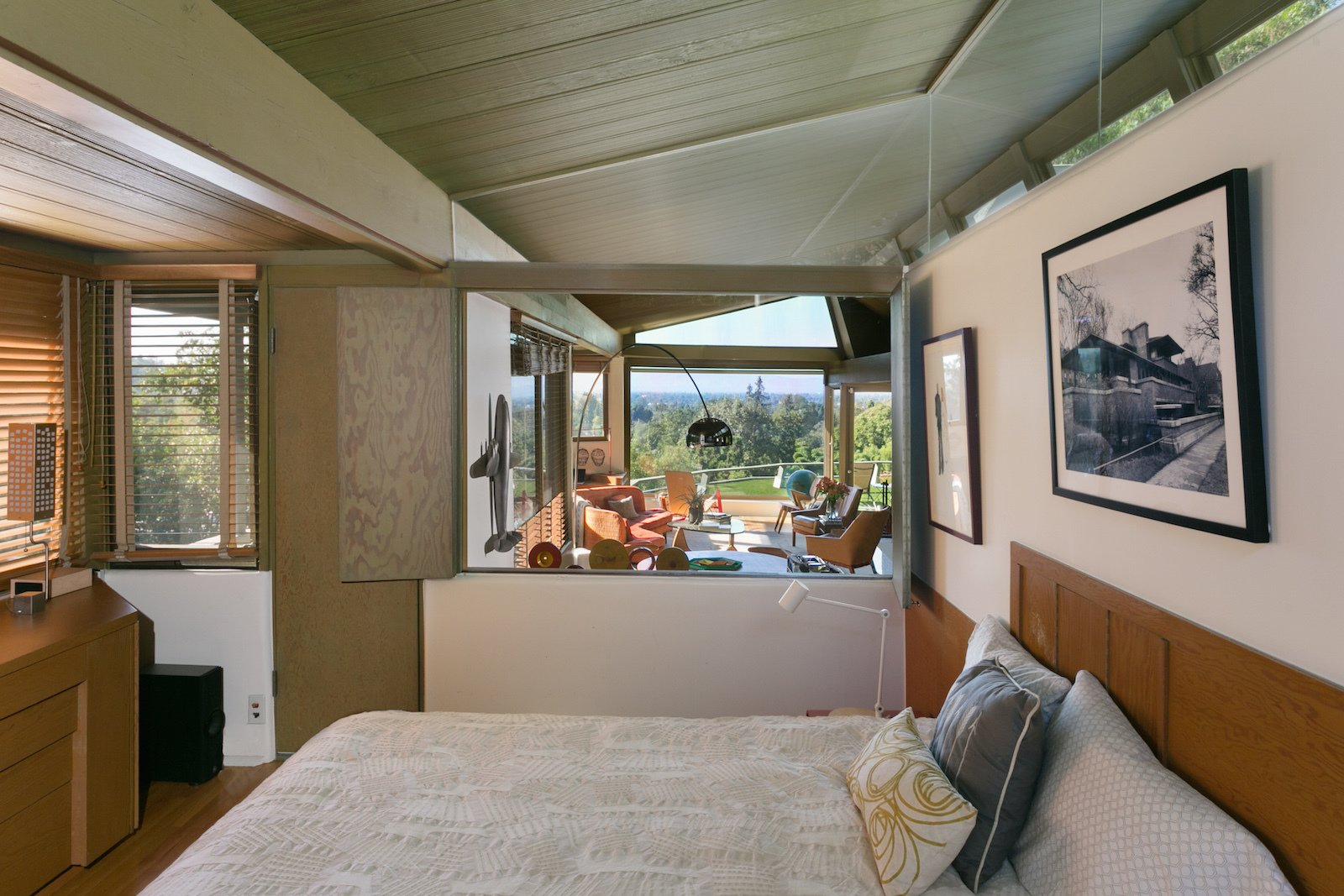 Bedroom, Bed, Night Stands, Table Lighting, and Medium Hardwood Floor  Photo 10 of 17 in A Midcentury Schindler Gem With a Writer's Studio Asks $2.3M