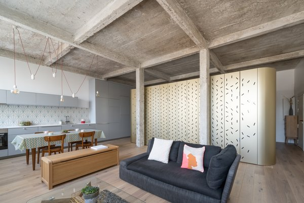 An Ingenious Gold Island Transforms an Industrial Apartment in Paris