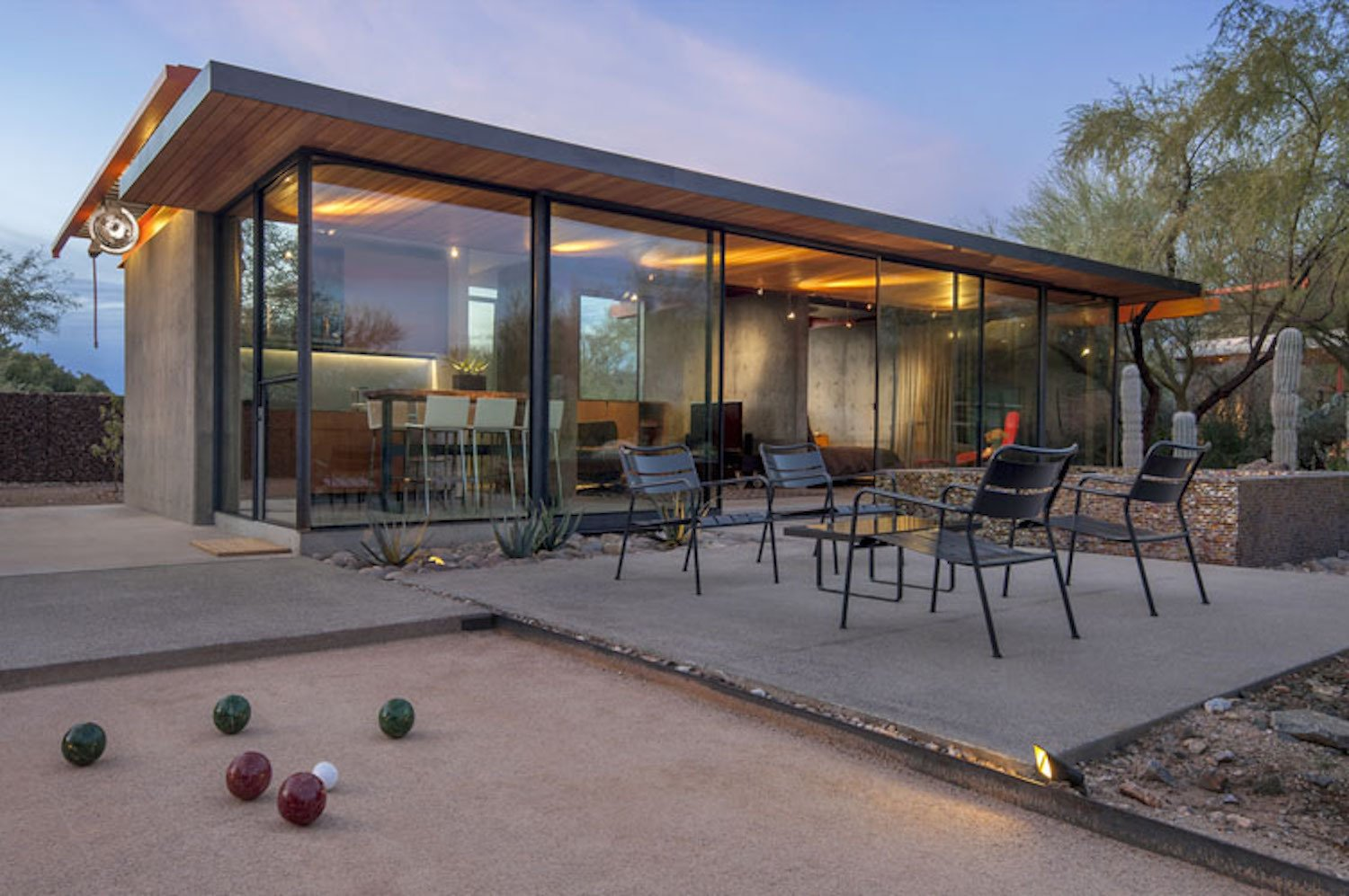 Outdoor, Landscape Lighting, Back Yard, Concrete Patio, Porch, Deck, Boulders, and Desert  Photo 6 of 12 in An Old Horse Barn Is Repurposed as a Chic Desert Guesthouse