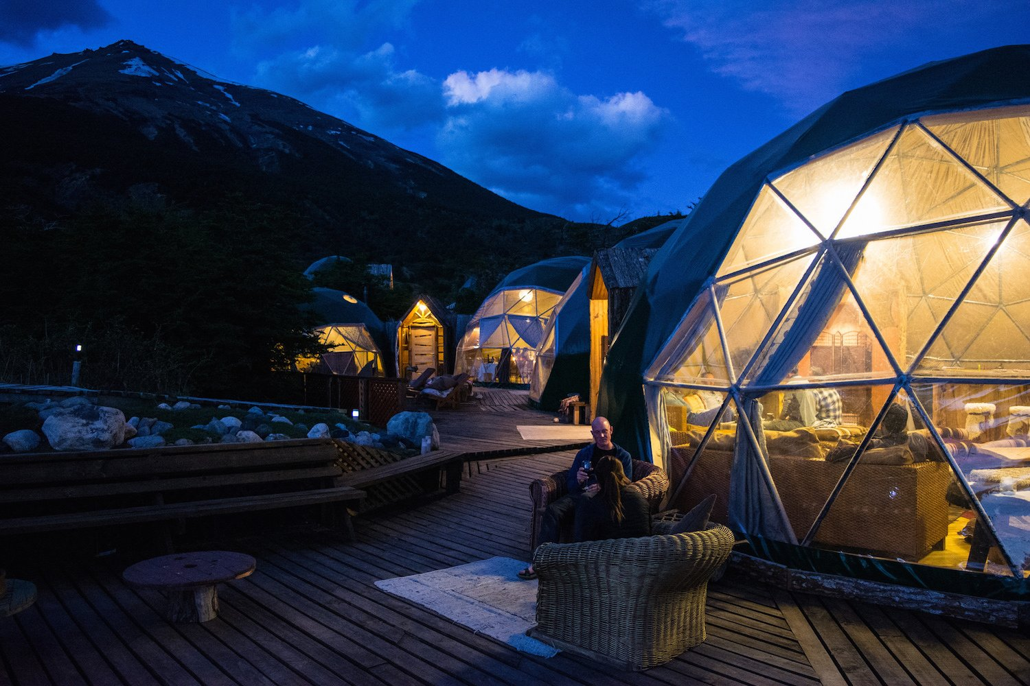 Outdoor, Decking Patio, Porch, Deck, Hardscapes, Large Patio, Porch, Deck, Wood Patio, Porch, Deck, Shrubs, Walkways, Boulders, Trees, Field, Woodland, and Slope  Photos from Soak Up the Magic of Patagonia at This Eco-Friendly Geodesic Dome Retreat