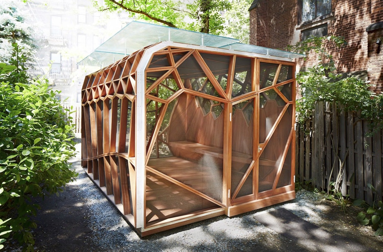 Exterior, Flat RoofLine, Cabin Building Type, Prefab Building Type, and Wood Siding Material  Photo 2 of 8 in This Prefab Backyard Pavilion Mimics a Dragonfly's Wings