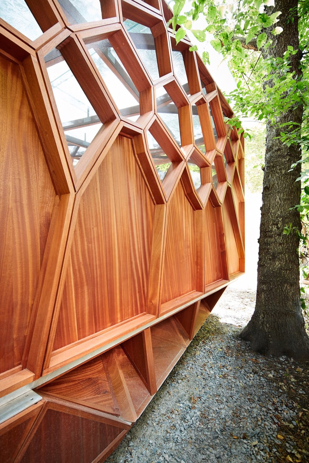 Exterior, Flat RoofLine, Prefab Building Type, Wood Siding Material, and Cabin Building Type  Photo 6 of 8 in This Prefab Backyard Pavilion Mimics a Dragonfly's Wings