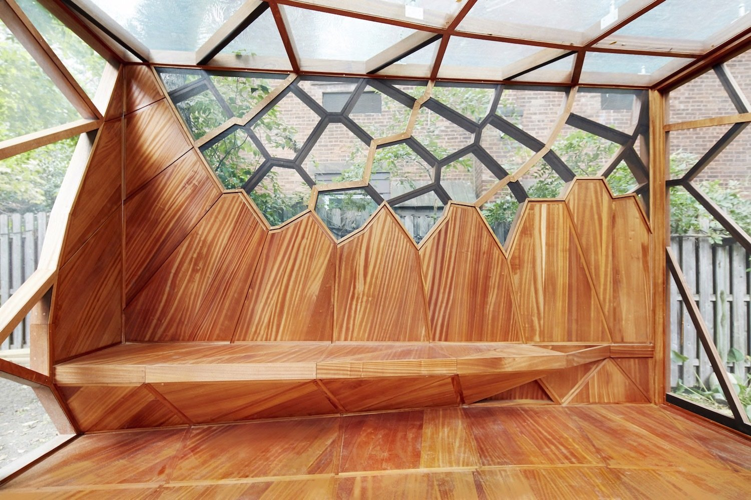 Living Room, Medium Hardwood Floor, and Bench  Photo 7 of 8 in This Prefab Backyard Pavilion Mimics a Dragonfly's Wings