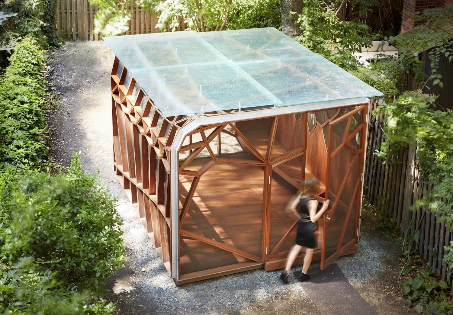 Exterior, Flat RoofLine, Wood Siding Material, Prefab Building Type, and Cabin Building Type  Photo 8 of 8 in This Prefab Backyard Pavilion Mimics a Dragonfly's Wings