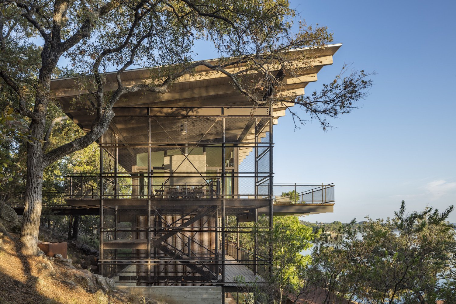 Exterior, Shed RoofLine, Metal Siding Material, Glass Siding Material, and House Building Type  Photo 1 of 11 in A Spectacular Lakeside Retreat in Texas Embraces the Outdoors