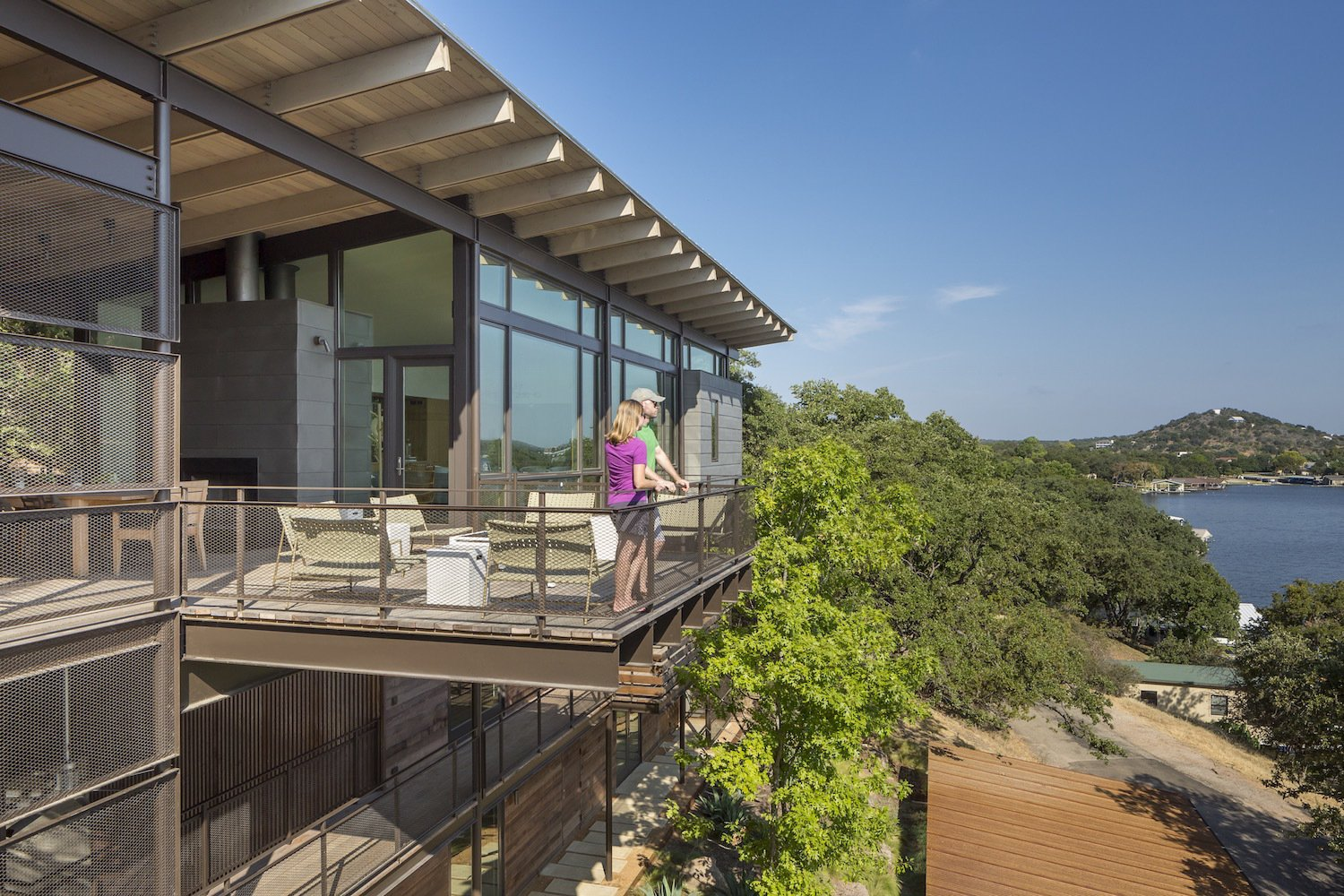 Outdoor, Wood Patio, Porch, Deck, and Trees  Photo 6 of 11 in A Spectacular Lakeside Retreat in Texas Embraces the Outdoors