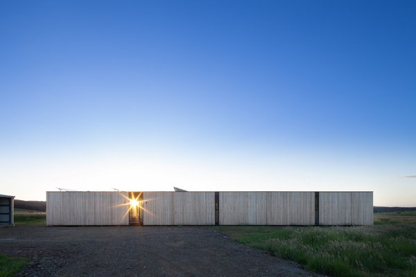 Two Families Embrace Off-Grid Living in This Sustainable Prefab Home - Photo 1 of 9 -
