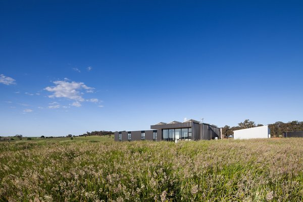 Two Families Embrace Off-Grid Living in This Sustainable Prefab Home - Photo 3 of 9 -