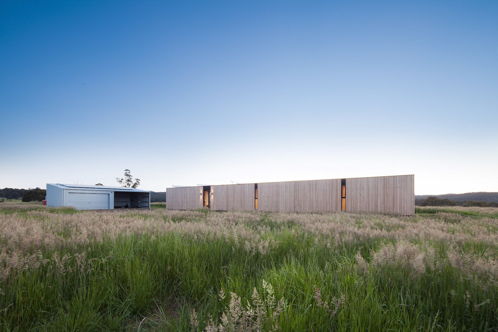 Exterior, Flat RoofLine, Prefab Building Type, Wood Siding Material, and House Building Type  Photos from Two Families Embrace Off-Grid Living in This Sustainable Prefab Home