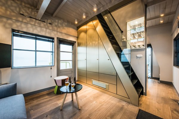 Timber floors add warmth to the compact apartment.