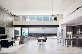 Glass walls open this living room up to the outdoors.