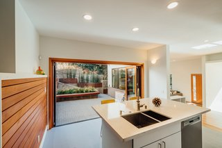 Aluminum Wood provides warmth to this modern, clean-lined kitchen.