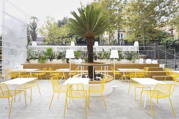 Bright yellow seating injects vibrancy into the space.