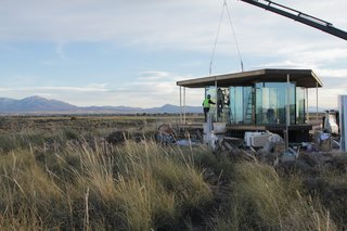 Go Stargazing in This Off-Grid Glass Prefab Nestled in the Desert - Photo 3 of 13 - Once the prefabricated parts arrived from Slovenia, OFIS Architects assembled the structure within a week.