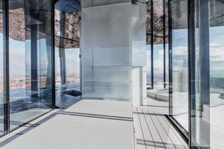 Go Stargazing in This Off-Grid Glass Prefab Nestled in the Desert - Photo 6 of 13 - Here's a look at the central core from the bedroom, which houses storage.