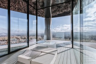 Go Stargazing in This Off-Grid Glass Prefab Nestled in the Desert - Photo 8 of 13 - Curtains can be pulled along an integrated track for greater privacy or shade.