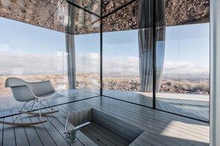 Go Stargazing in This Off-Grid Glass Prefab Nestled in the Desert - Photo 5 of 13 - The sunken bathtub overlooks stellar panoramic views.