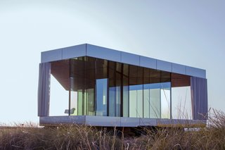 Go Stargazing in This Off-Grid Glass Prefab Nestled in the Desert - Photo 4 of 13 - The prefab house is completely off-grid.