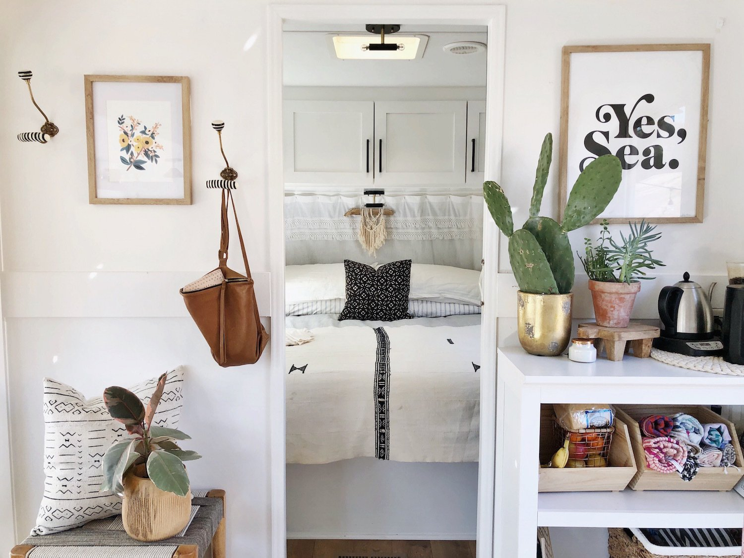 The couple kept costs low by sourcing art and furniture from garage sales, IKEA, Amazon, and Target. Tagged: Bedroom, Storage, Bed, Medium Hardwood Floor, and Ceiling Lighting.  Photo 4 of 11 in A Couple Spend $3K to Turn an Old RV Into a Cozy Home For Five