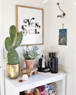 Pops of greenery and art imbue warmth into the tiny home.