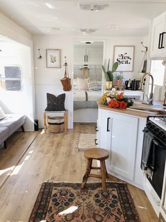 "A peek inside the RV after the revamp. The couple spent three weeks renovating the space and did most of the work themselves. ""My husband had worked in construction a little so he had a general background of basic things and we just figure out how to do things if we don't know how,"" explains Ashley."