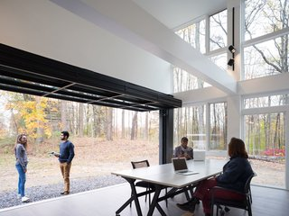Ample glazing blurs the distinction between indoors and out.