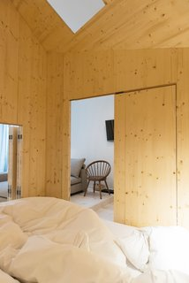 Stoke Your Imagination With This Playhouse-Like Suite in Berlin - Photo 4 of 7 - There is also a staircase that leads to a second bedroom and hammock/sitting area. The slight changes in elevation help to create added visual interest within the suite.