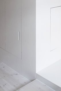When the doors are closed, they appear flushed against the white facade.