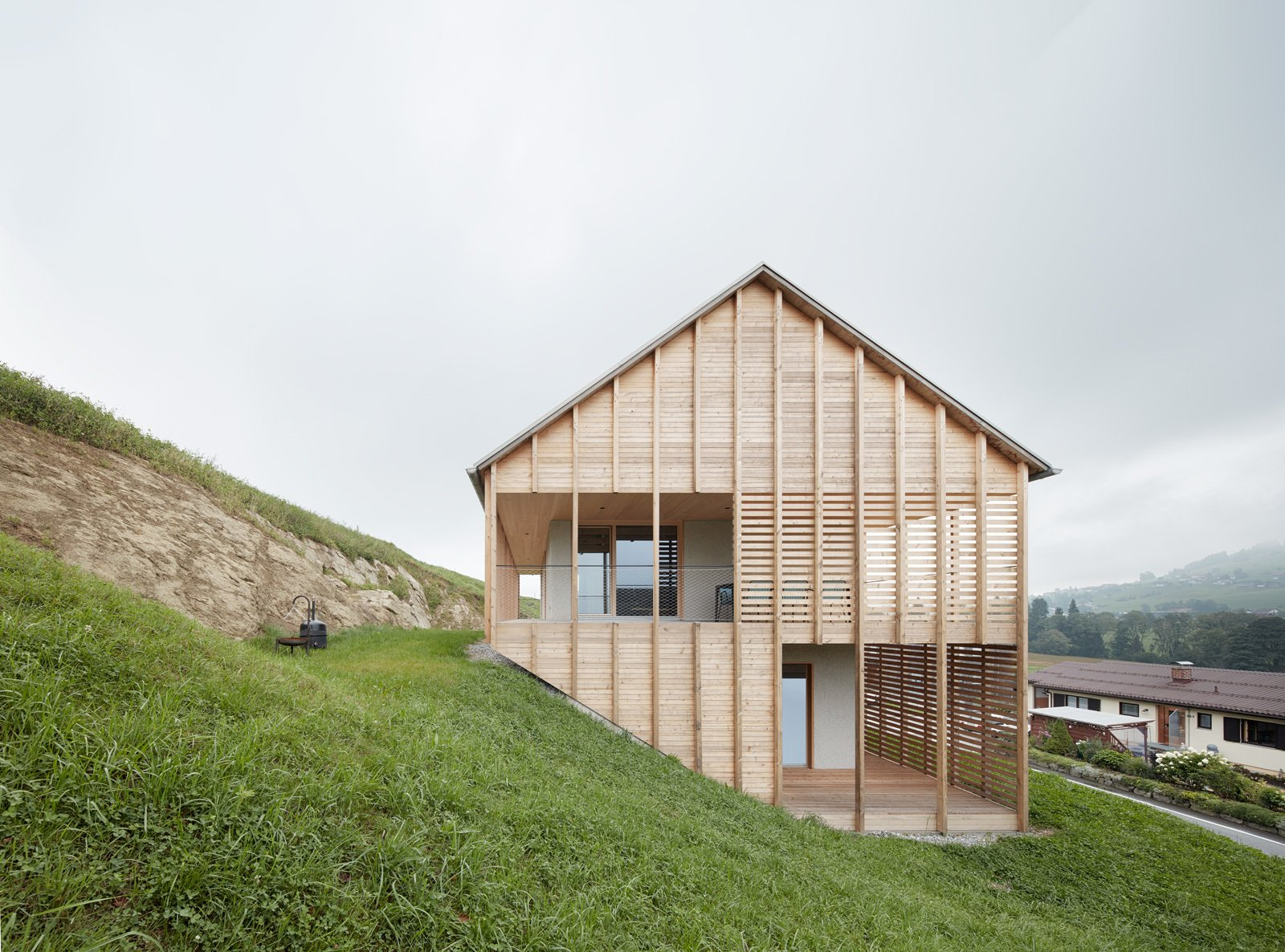 A Minimalist Home Is Built Into Steep Terrain In An Austrian Valley