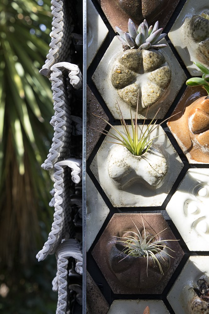 """The """"Seed Stitch"""" tiles to the left are made from clay, while the """"Planter Tiles"""" are printed from a mix of biodegradable waste materials."""