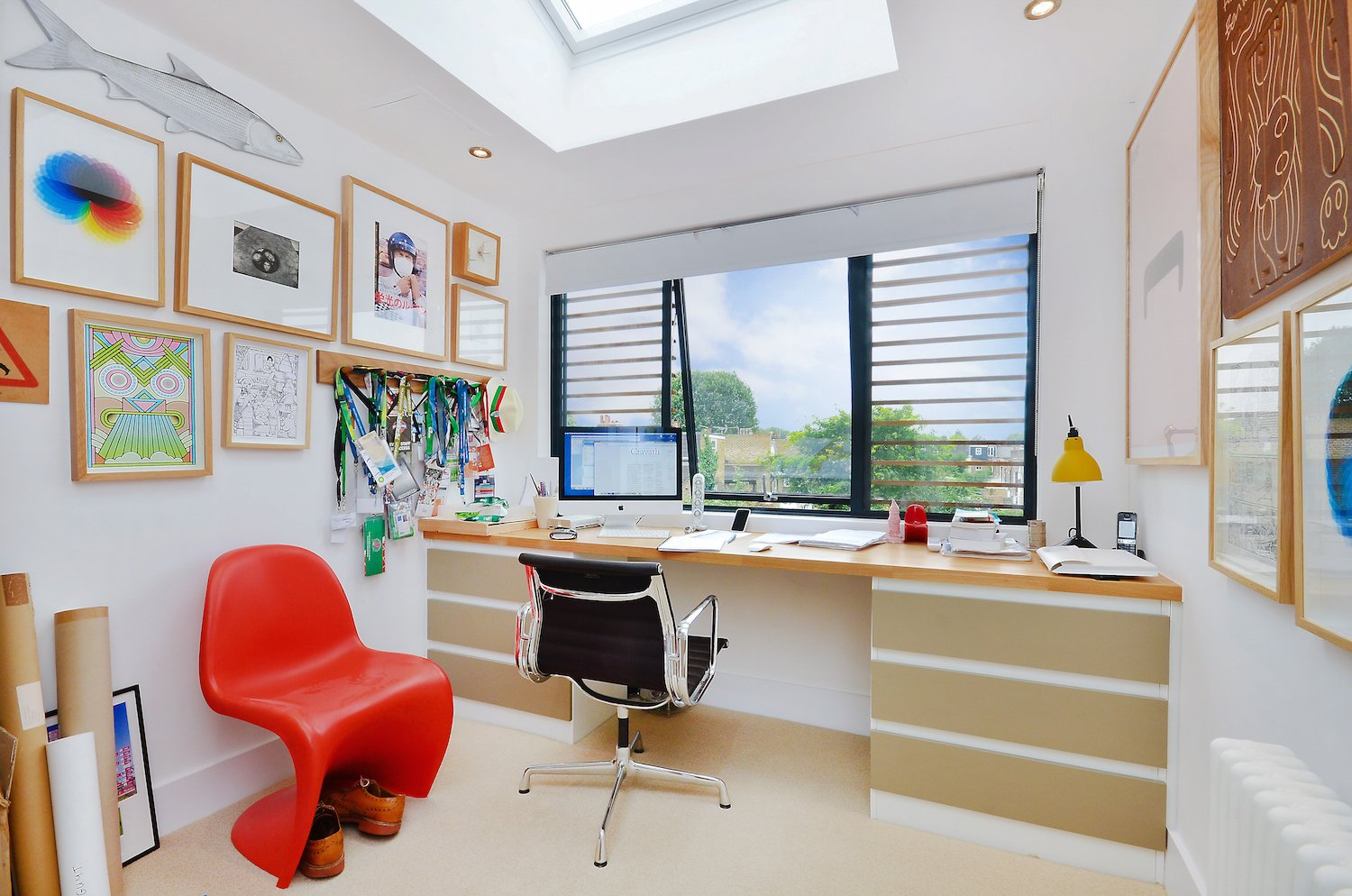 Set beneath a skylight, the fourth bedroom has currently been transformed into a study.