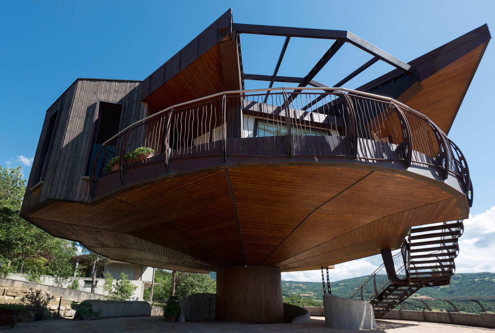 Exterior, House Building Type, Wood Siding Material, Metal Roof Material, and Prefab Building Type The house is accessed via an external staircase built of wood and wrought iron.   Photo 2 of 8 in This Octagonal Prefab in Italy Rotates a Full 360 Degrees to Follow the Sun