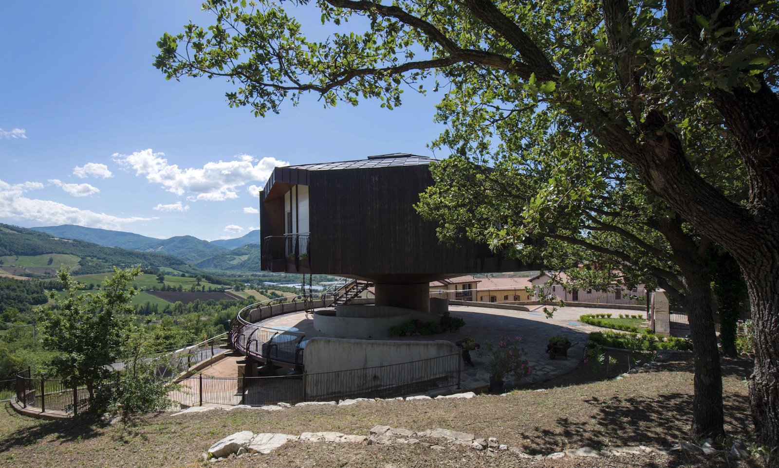 Exterior, Wood Siding Material, Metal Roof Material, House Building Type, and Prefab Building Type Solar panels are integrated into the metal roof.  Photo 5 of 8 in This Octagonal Prefab in Italy Rotates a Full 360 Degrees to Follow the Sun