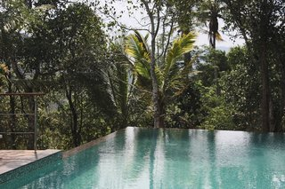 A nearly 50-foot-long infinity pool, also raised on stilts, overlooks views of the striking cardamon plantations.